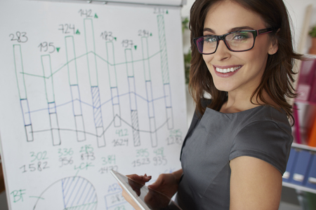 Woman standing next to the white board Stock Photo