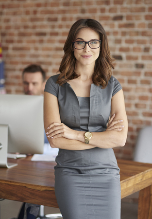 Portrait of woman in her office Stock Photo