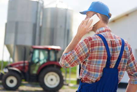Rear view of farmer talking on the phone