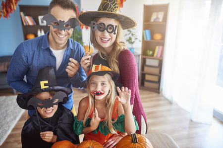 Family wearing funny halloween masks Stock Photo