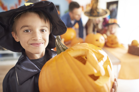 turn table: Little boy with big Halloween pumpkin Stock Photo