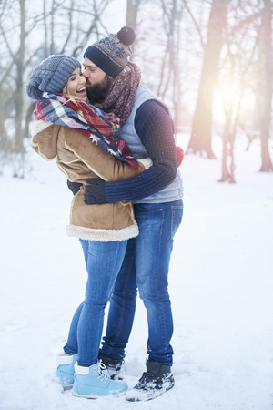 winter couple: Big kiss in winter scenery Stock Photo