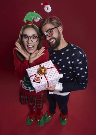 unfashionable: Happy couple with Christmas present