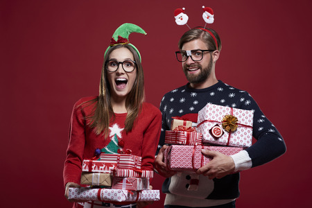Christmas couple carrying heavy presents Stock Photo