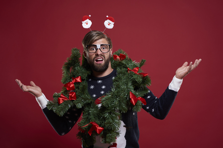 unfashionable: Man in embarrassing Christmas garland