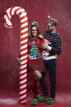 unfashionable: Funny Christmas couple in snow
