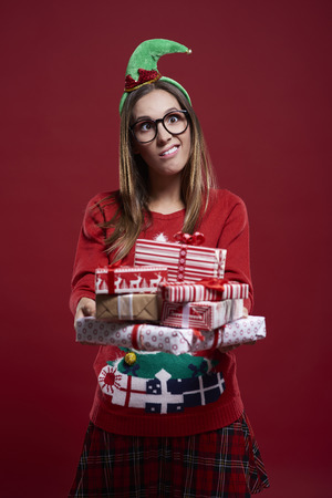 christmas woman: Woman with christmas gifts and funny face