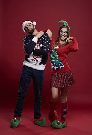 red cardigan: Funny couple in Christmas time  Stock Photo
