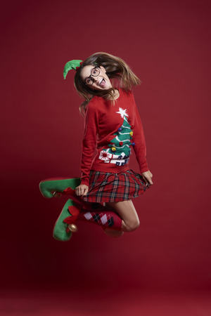 unfashionable: Jumping woman in Christmas clothes  Stock Photo