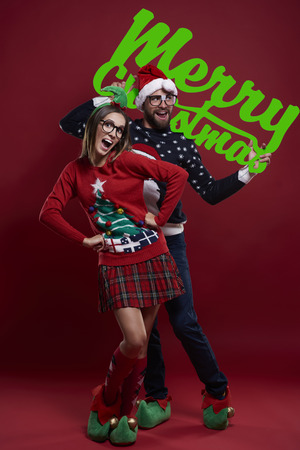 unfashionable: Christmas time with funny couple Stock Photo