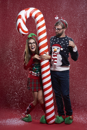 unfashionable: Couple standing next to the candy cane Stock Photo