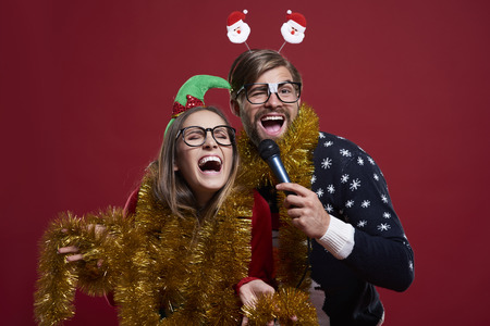 Having karaoke party during christmas time Stock Photo - 63189185