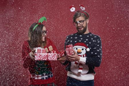 glasses eye: Christmas nerd couple with presents