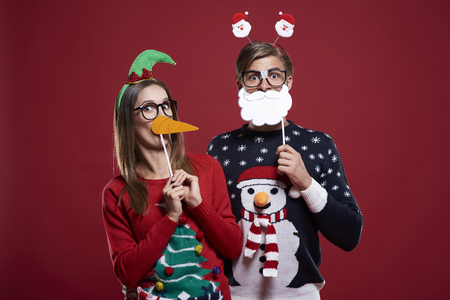 red cardigan: Bizarre couple in Christmas time Stock Photo