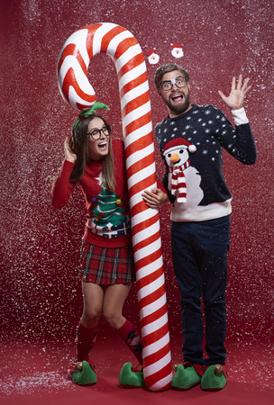 unfashionable: Couple standing with red and white christmas cane