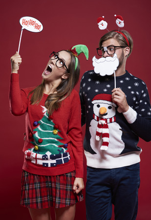 red cardigan: Christmas masks and couple of nerds
