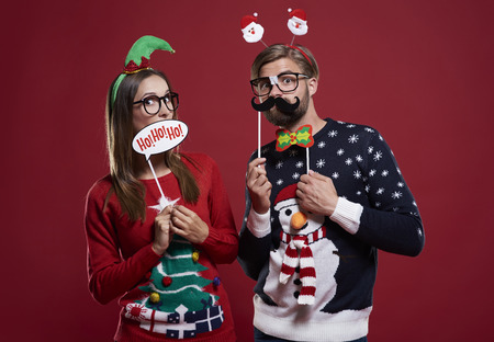 unfashionable: Boyfriend and girlfriend with Christmas masks  Stock Photo