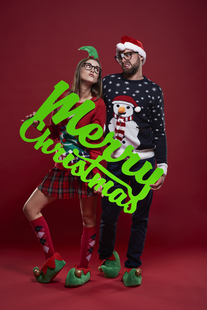 Nerd couple with the best wishes for Christmas  Stock Photo