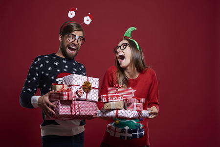 Funny Christmas nerds with presents Stock Photo