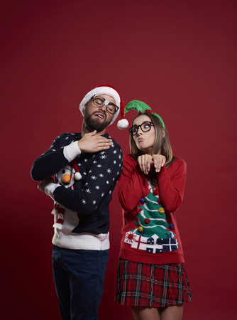 unfashionable: Nerd couple in Christmas time