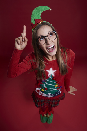 eccentric: Christmas female elf with finger up  Stock Photo