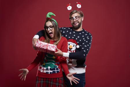 gift giving: Funny man giving the Christmas gift
