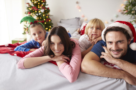 christmas spending: Loving family spending Christmas in bed