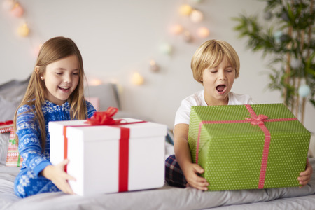 open present: Happy kids with Christmas presents