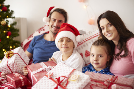 christmas spending: Family spending Christmas morning in bed Stock Photo