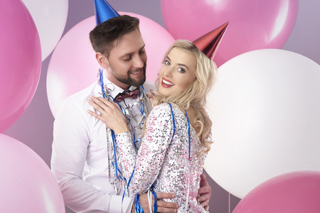 party hat: Couple dancing among colorful balloons