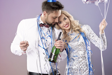desire: Cheerful couple at the New Years Eve