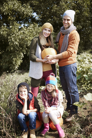 family portrait: Portrait of family in autumn day