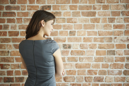 rear view: Rear view of elegant woman on the wall