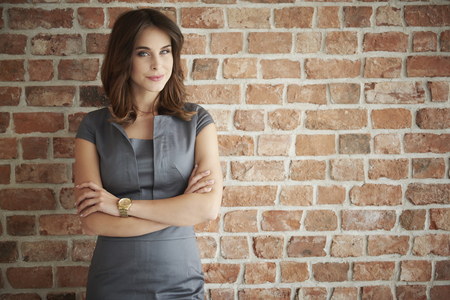 Pensive woman with arms crossed Stock Photo - 63971309