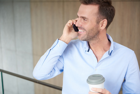 telephone call: Busy man with a cup of coffee Stock Photo