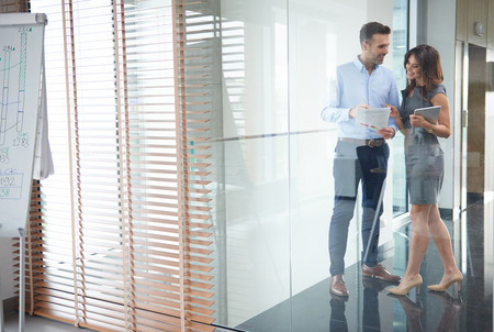 business partners: Business partners behind glass wall