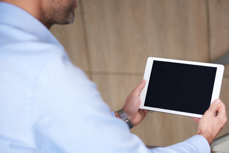 busy person: Digital tablet held by business person