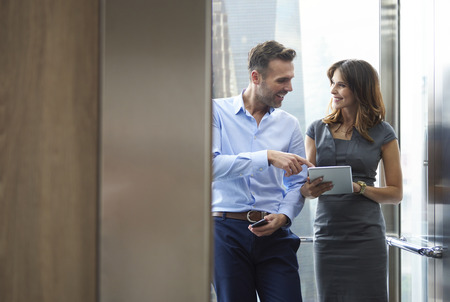 Business man and woman in the elevator