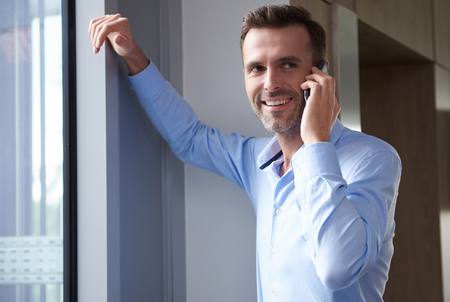 telephone call: Company manager next to the window