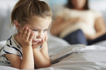 Girl not satisfied with her new sibling Stock Photo