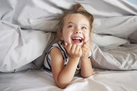 Girl having fun in her bed