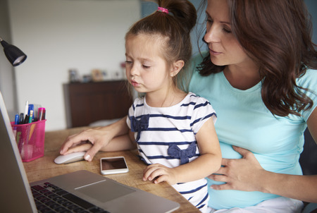 use computer: Mother showing daughter how to use computer