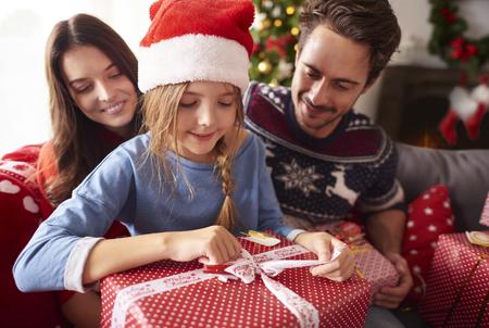 happy family opening christmas presents stock photo 64875409