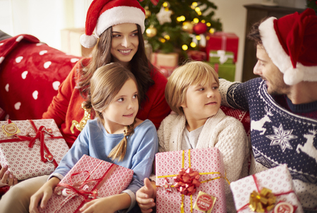 christmas spending: Family spending Christmas together at home