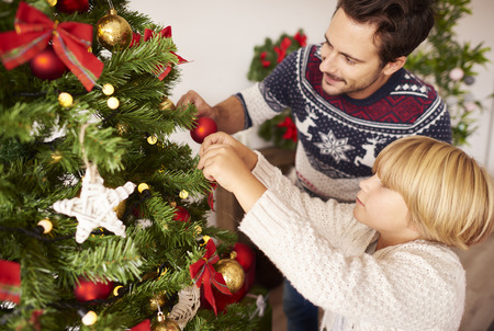 decorating christmas tree: Decorating Christmas tree with daddy