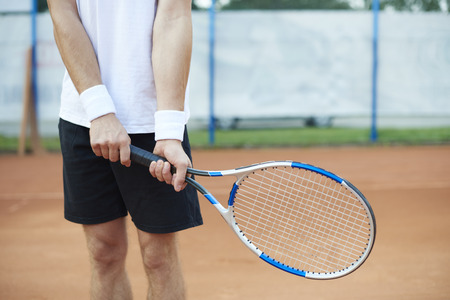 The man is holding a tennis racket Stock Photo