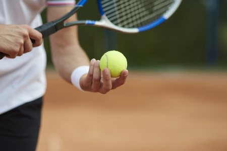 Tennis player is trying to hit the score