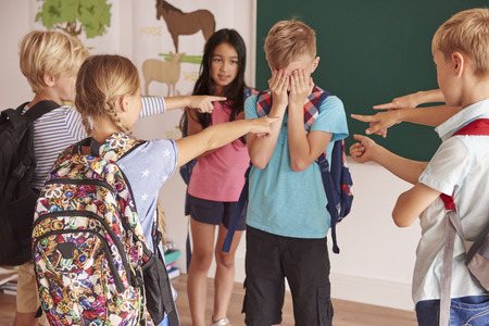 embarassment: Kids laughing at their classmate Stock Photo