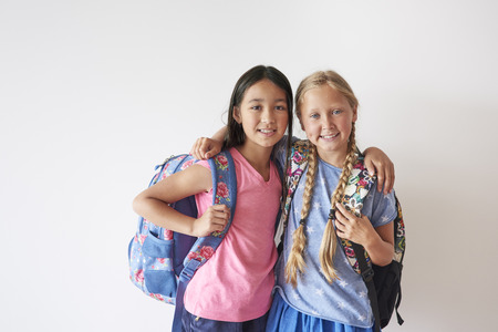 study group: Two best friends with backpacks Stock Photo