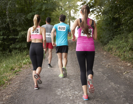 rival rivals rivalry season: Rear view on the running people